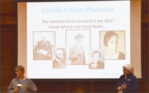 Facilitators Lois Kitsch and Debbie Wege lead a group discussion about credit union pioneers.